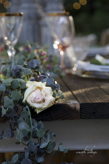 garland draped on table for table setting