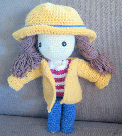 Crochet pattern amigurumi doll girl with yellow hat and coat