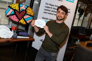 Daniel signs mini brain for the Baycrest Foundation