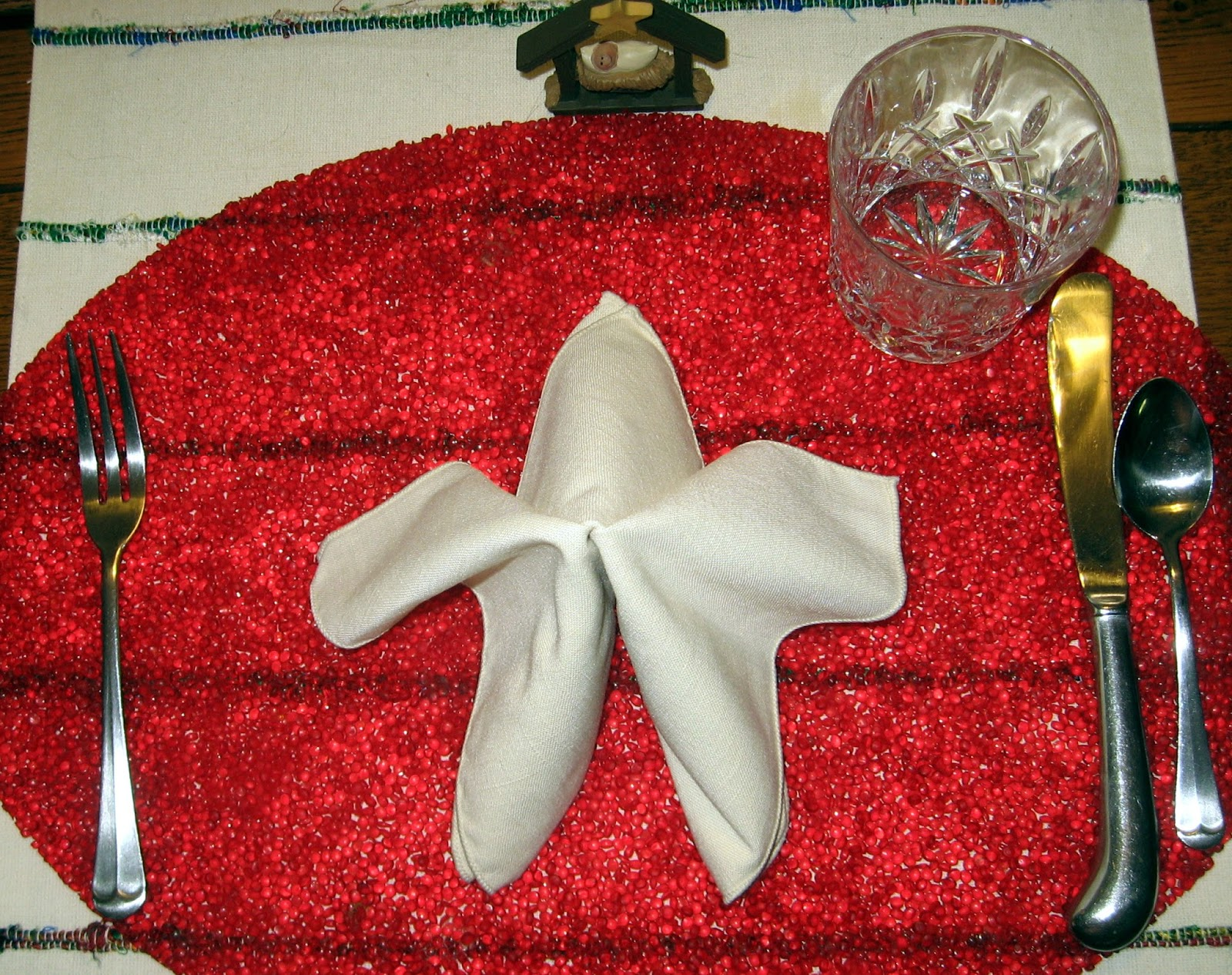 each place setting included napkins folded like stars and a mini nativity favor menu - Christmas Dinner Blessings
