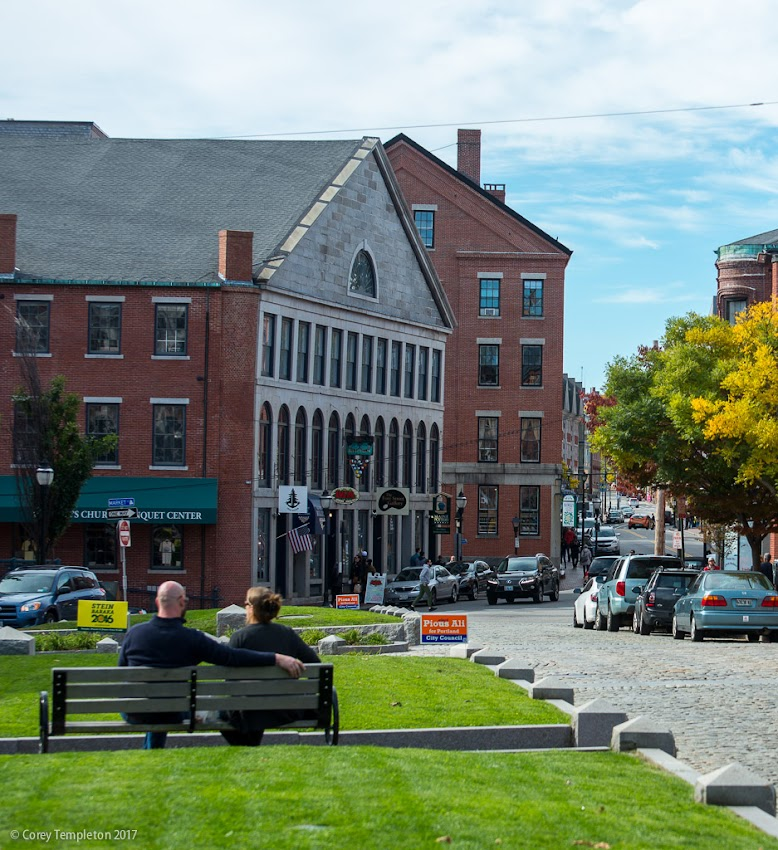 Portland, Maine USA October 2016 photo by Corey Templeton. A well-placed bench in Boothby Square provides a nice spot to watch the hustle and bustle of the Old Port.