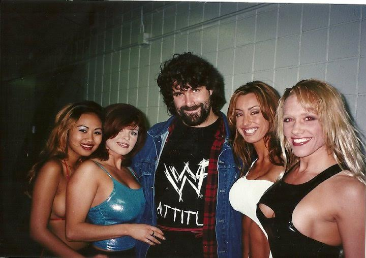 Mick Foley in agreable company during the WWF Attitude Era. StrengthFighter.com