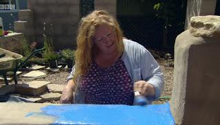 Charlie paints the rustic farmhouse blue