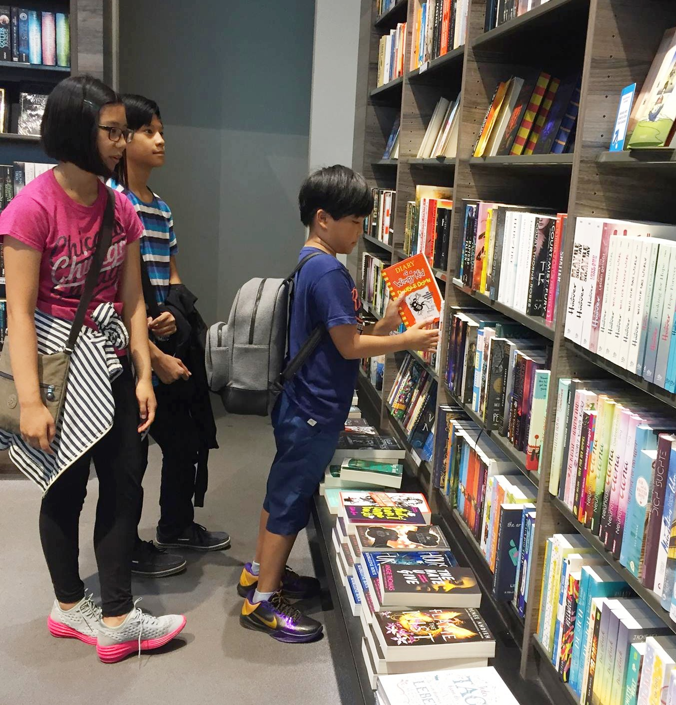 kids in bookstore, Ways to Teach Your Kids the Value of Real Estate and Investing