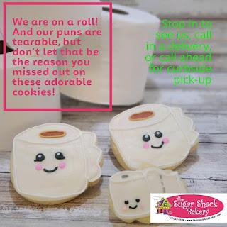 sugar cookies that look like smiling kawaii toilet paper rolls