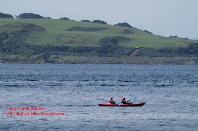 Kayak sailing past Cumbrae Island