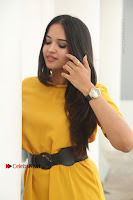 Actress Poojitha Stills in Yellow Short Dress at Darshakudu Movie Teaser Launch .COM 0094.JPG