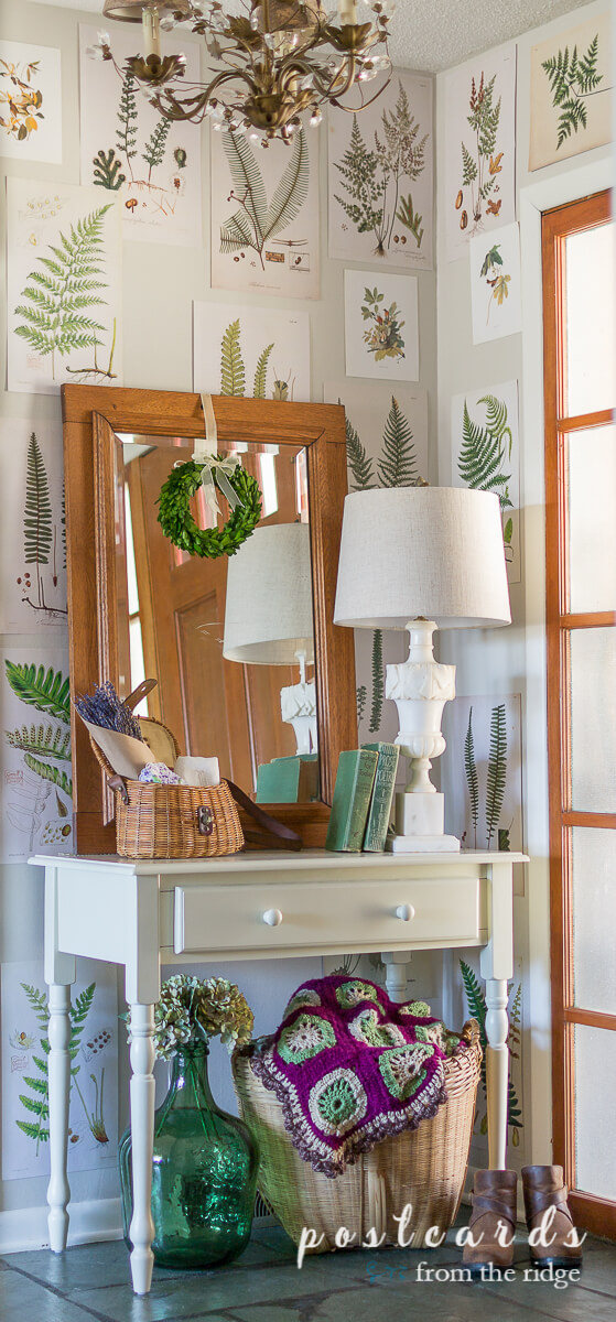 small white desk and entry decor with fern prints