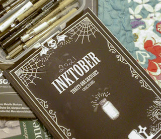 Image of the Inktober sketchbook with other sketchbooks and multiple pens