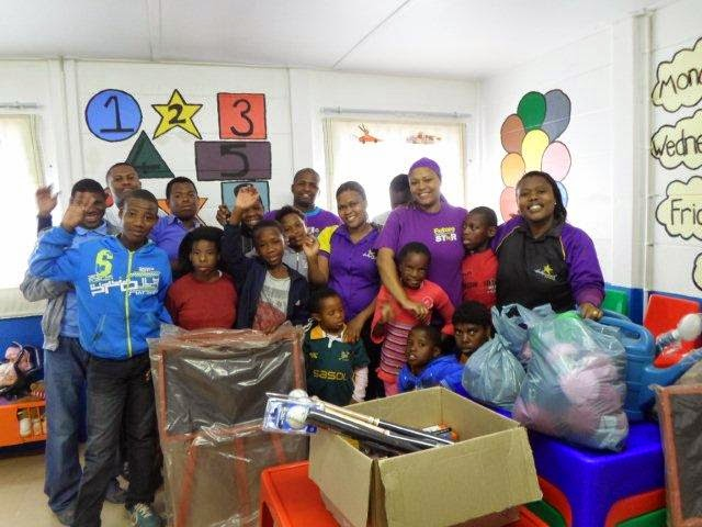 Hollywoodbets Manadarin Inn team members with children from the Khaya Cheshire Home - CSI - Social Responsibility