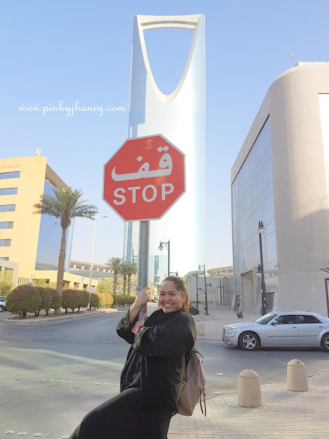 Photo of me taken when I was in Riyadh, Kingdom of Saudi Arabia. Behind me is the                                                               Kingdom Tower, one of the tourist spot in Riyadh.