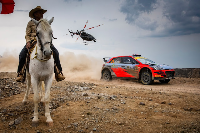 Hyundai rally car, helicopter and horse rider all in photo