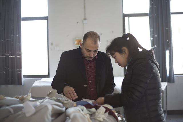 Alo-baidi Mohammed (L), an Iraqi factory owner, inspects products with his employee in Jinghua, Zhejiang Province, China 13 January 2017. To match story CHINA-MIGRANTS/MIDEAST Thomson Reuters Foundation