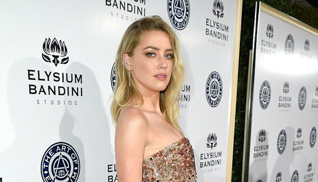 Wow!  Amber Heard Pamer Foto 'Topless' Saat Liburan di Bali