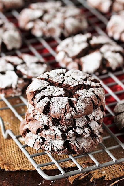 Stack of Chocolate Crinkle Cake Mix Cookies on Cooling Rack Image