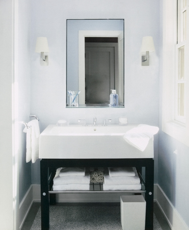 Photo of white sink in modern bathroom of restored cottage