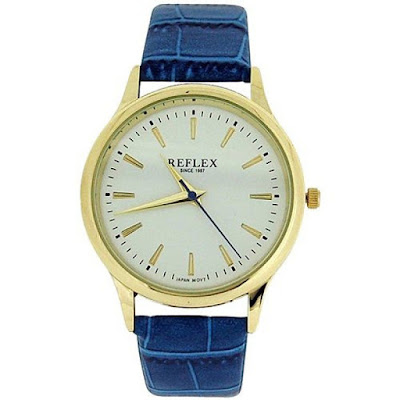 Reflex Wrist Watch With Gold Tone Bezel With White Face