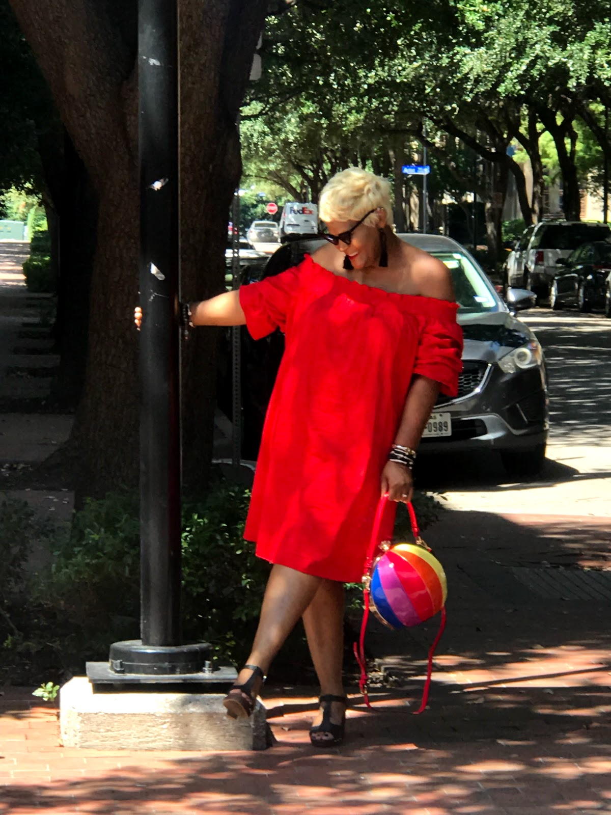 Image:Woman wearing Red dress posing in outfit with balloon purse. Seen first on Bits Babbles by Tangie Bell