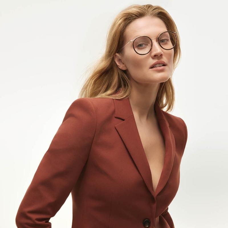 Model Toni Garrn wears optical frames from BOSS.