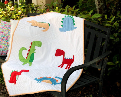 Applique dinosaur baby quilt with flannel backing