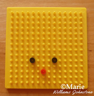 Yellow pegboard with fused perler beads