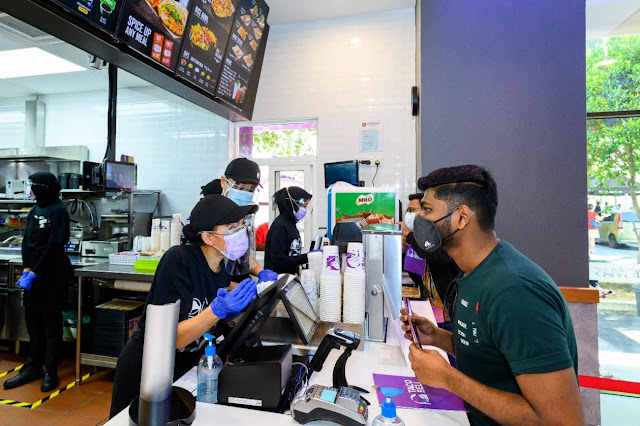 aco Bell Malaysia's first customer, Megentira, placing his order at the restaurant opening today at 10am.