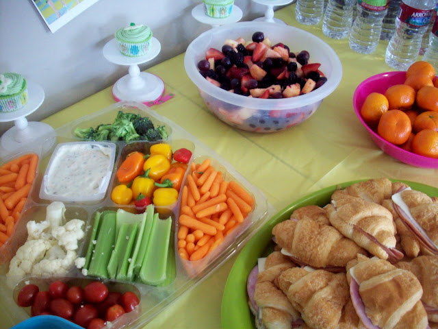 sandwiches, vege tray and fruit bowl