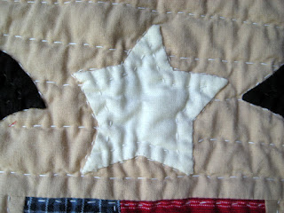 small hand appliqued and hand quilted star in primitive style