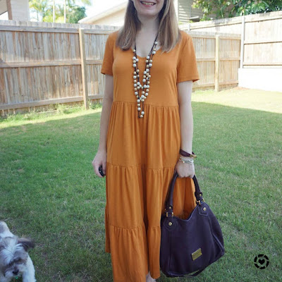 awayfromblue Instagram | Christmas shopping outfit amber Kmart tiered jersey midi dress with brown Marc Jacobs Fran bag