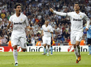 Kaka and Cristiano celebrating the second goal of the team