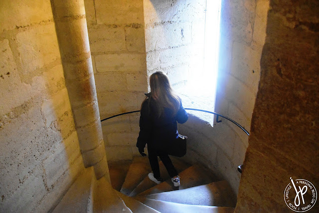 woman going down spiral staircase
