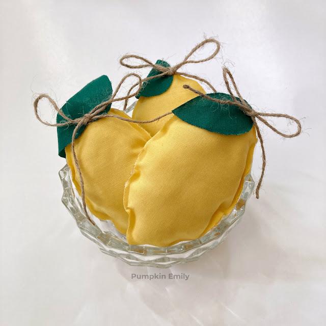 Three fabric lemons in a bowl.