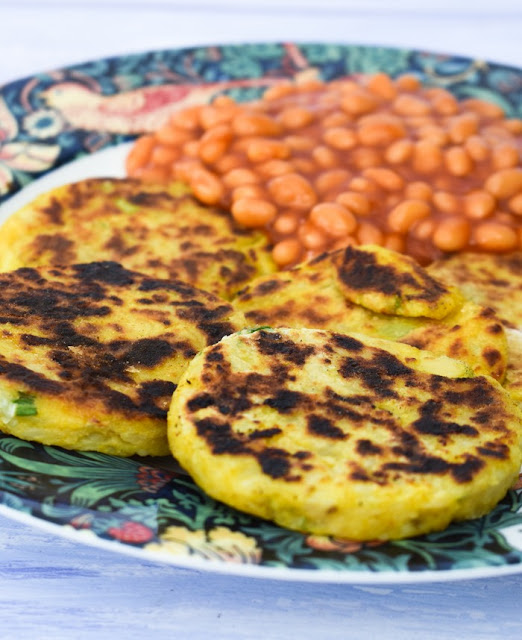 Easy Indian Spiced Potato Scones served on a plate with baked beans