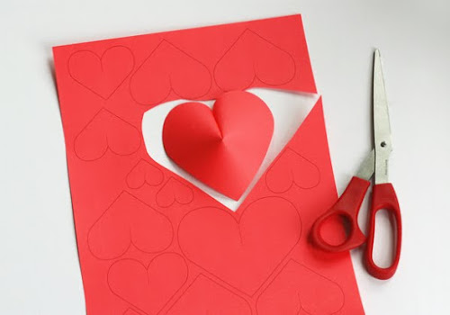 Lovely Diy Craft Ideas For Home Decor: Make a Wall of Paper Hearts