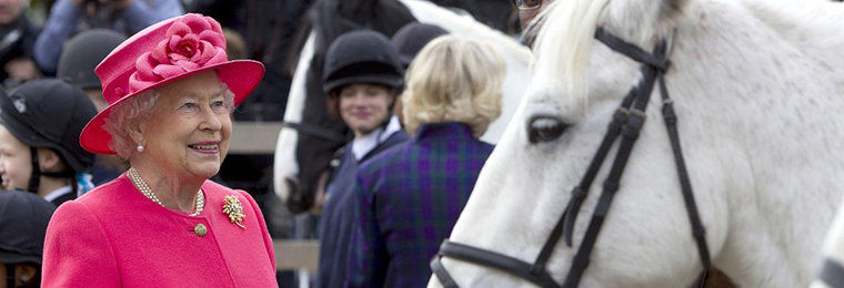 New Photos Show Queen's Love of Horses
