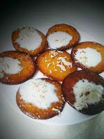 Serving Malpua with rabdi and nuts for recipe for Malpua