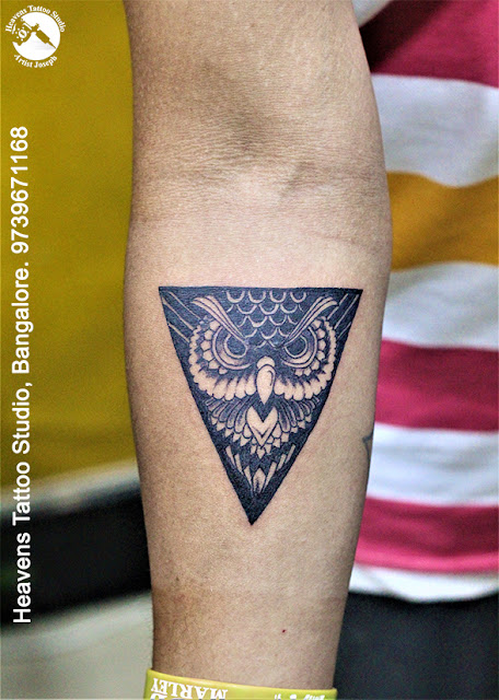 http://heavenstattoobangalore.in/triangle-owl-tattoo-at-heavens-tattoo-studio-bangalore/