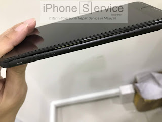 iPhone battery bloated screen outward
