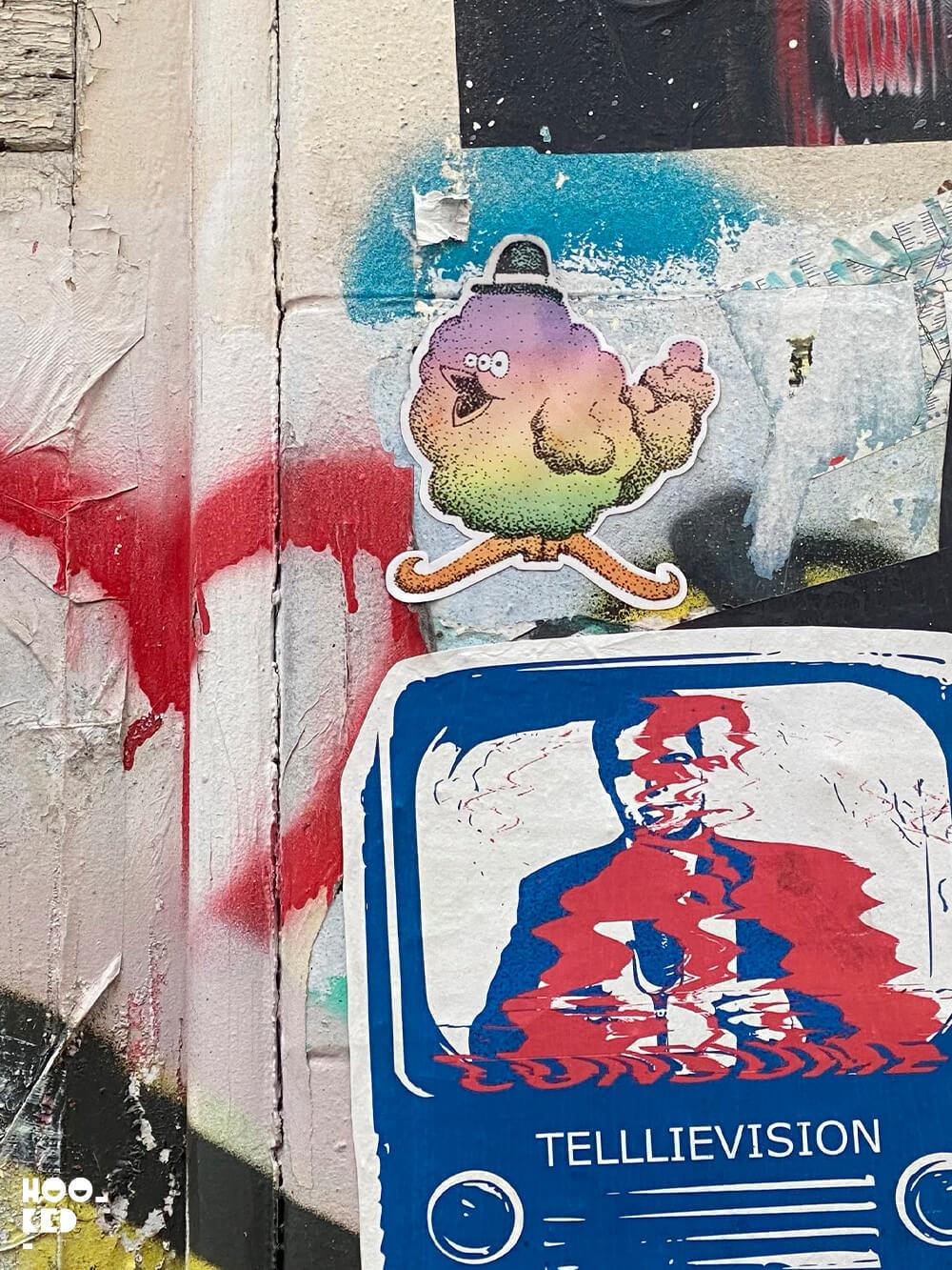 London street art stickers by artist Craig Robertson aka Purshone.