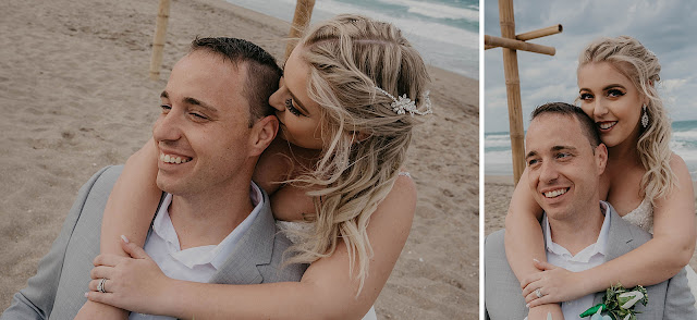 Bride holding Groom from behind on the beach
