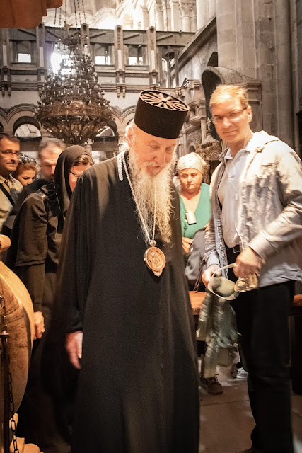 A Russian Orthodox Priest leaving mass in the Holy Sepulchre