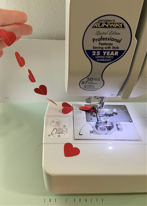 Paper Heart Banner - heart punches sewn on sewing machine
