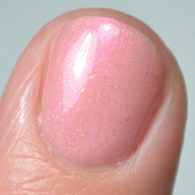 pink shimmer nail polish close up swatch