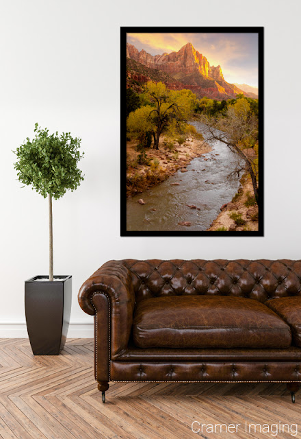 "Cramer Imaging's fine art photograph ""Zion's National Park"" staged in a living room space with a leather couch"