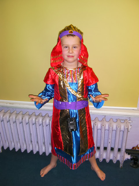 junior school nativity play wise man melchior brings gold as befits a king