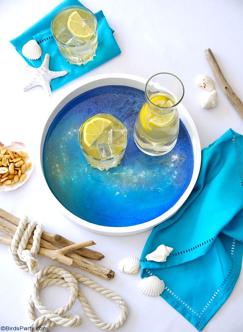 DIY Beach Inspired Epoxy Resin Tray - easy craft idea to serve drinks or to decorate your home and tables for summer! by BirdsParty.com @birdsparty #diy #crafts #resin #resinart #resincrafts #epoxyresin #resintray #summercarfts #beachcrafts #coastaldecor