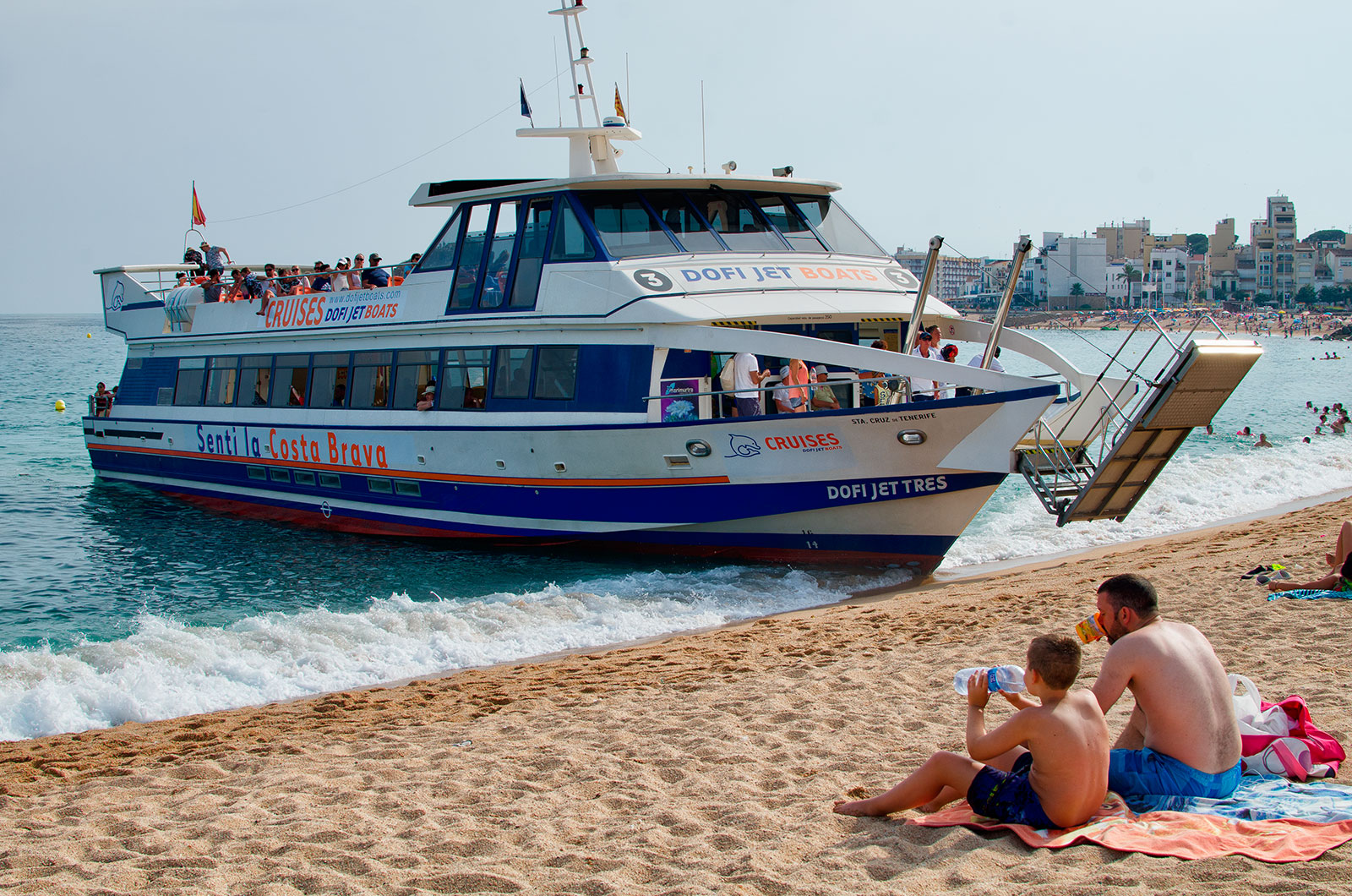 Sightseeing boat at Blanes beach in Costa Brava, Catalonia, Spain