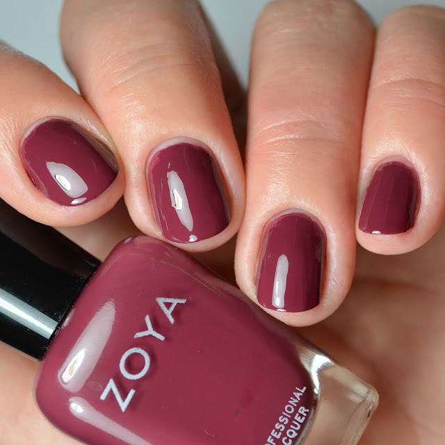 purple toned red creme nail polish swatch on four fingers