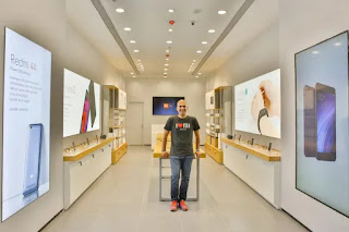 Xiaomi Super Sale-Great Discount On Smartphones,image of a man standing in a showroom,