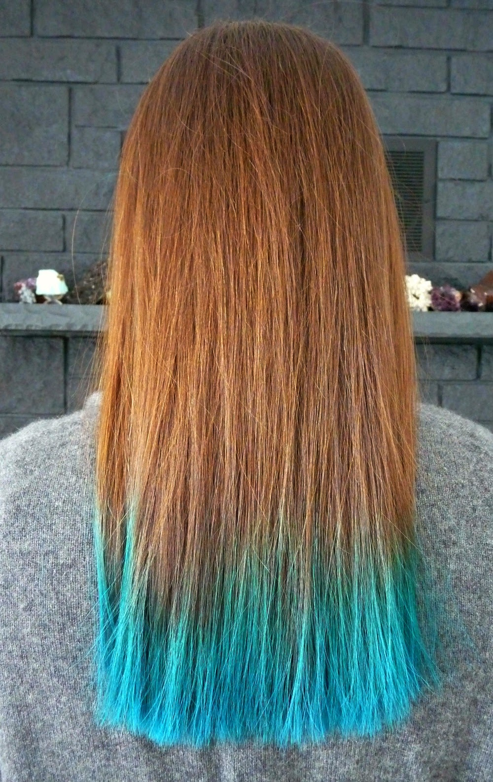 Brunette hair dip dyed aqua